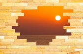 Crashed Brick Wall with beautiful sun set over the sea behind — Stock Photo
