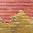 Golden mosaic on red brick wall — Stock Photo #32001891