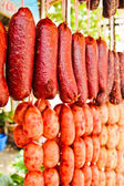 Home made meat salami sausage at street market hanging in line u — Stock Photo