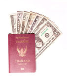 Us dollar banknote with Thailand passport on white background — Stock Photo