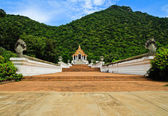 Beautiful thai church in front of the mountain against blue sky — Stock Photo