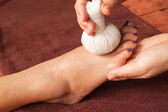Reflexology foot massage, spa foot treatment by ball herb,Thaila — Stock Photo
