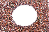 The white circle in many brown coffee beans for background — Stock Photo