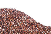 Many brown coffee beans for background — Stockfoto
