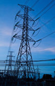 High voltage electricity pillars and blue sky in the morning — Stock Photo