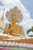 Golden Buddha and the blue sky,Wat Tham Khuha Sawan,Ubonratcheth — Foto de Stock