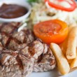 Juicy steak beef meat with tomato and potatoes — Stock Photo