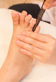 Reflexology foot massage by stick wood, spa foot treatment,Thail — Stock Photo
