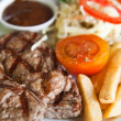 Juicy steak beef meat with tomato and potatoes — Stock Photo #32296513