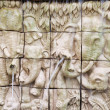 Elephants in low relief statue cut out as jig saw image and wate — Stock Photo #32298661