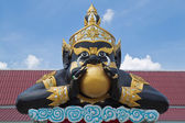 Statue of black deity called Rahu and blue sky background. — Stock Photo