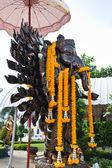 Many cast bronze hands of god Ganesha with yellow garland,Wat Sa — Stock Photo
