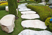 Seat and stone walkway in the park. — Stock Photo