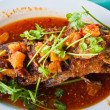 Fried grouper fish with sauce,sour and spicy on white plate,Thai — Stock Photo