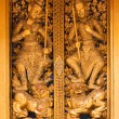 Close up of Thai style wood carving on the door of church in tha — Stock Photo