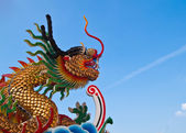 Chinese dragon and the blue sky in shrine,East of Thailand — Stock Photo