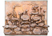 Traditional Thai style old iron statue plate on white wall in th — Stock Photo