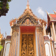 Thai style wood carving on the door of church in thai temple,Tha — Stock Photo #32642369