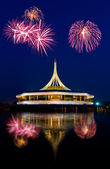 Beautiful building with fireworks — Stock Photo