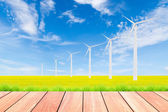 Wind turbine on green rice field against blue sky background — Stock Photo