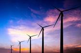 Wind turbine silhouette on colorful sunset — Stock Photo