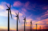 Wind turbine silhouette on colorful sunset — Stock Photo