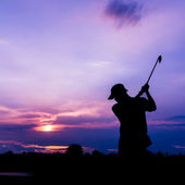 Silhouette golfer at sunset  — Stock Photo