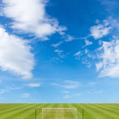 Soccer field with blue sky background — Stock Photo