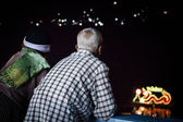 Asian senior couple view river decorated light — Stock Photo