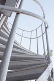 White iron steps of spiral staircase — Stock Photo