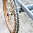 Apart of trailer old tyre muddy — Stock Photo