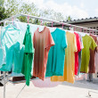 Laundry hanging out to dry outdoors in summer — Stock Photo