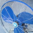 Front of industrial fan on blue floor — Stock Photo