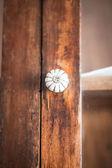 Closeup of old fashioned door knob on wooden door — Stock Photo