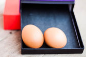 Eggs in a gift box — Stock Photo
