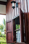 Side window porch of traditional old house — Stock Photo