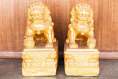 Chinese style figurine couple golden singha — Stock Photo