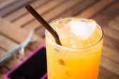 Break time with fresh iced orange juice — Stock Photo