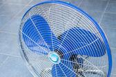 Front of industrial fan on blue floor — Stock Photo