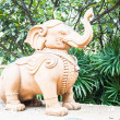 Elephant sculpture decorated green garden of tropical resort  — Stock Photo