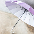 Stock Photo: Purple silver bronze uv protection umbrellon floor