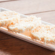 Traditional crispy rice cracker on white plate  — Zdjęcie stockowe