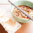 Meal set of picy noodle soup and crispy rice cracker — Stock Photo #31592429