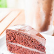 Bitter sweet meal with iced coffee and chocolate cake  — Stock Photo