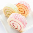 Colorful jam roll cakes  on the dish — Lizenzfreies Foto