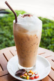 Refreshing glass of cold espresso and some sweet — Stockfoto