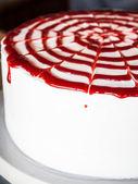 Rasberry sauce topped white whipped cream cake — Stock Photo