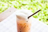 Break time with cold thai milk tea — Stock Photo