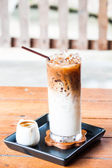 Iced coffee latte with espresso shot in white jar — Stock Photo