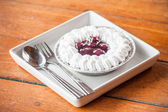Cheesecake with blueberries sauce and whipped cream — Stock Photo